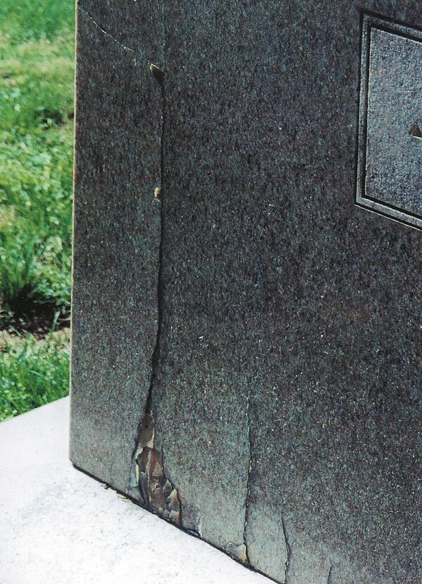 low quality granite headstone with crack-1-1