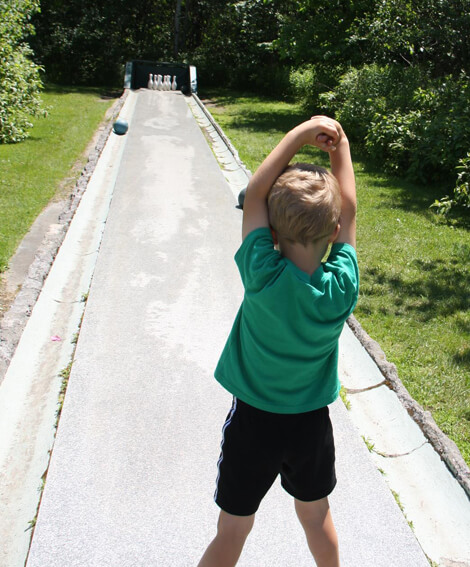 Child bowling on E.L. Smith quarry tour in Barre Vermont