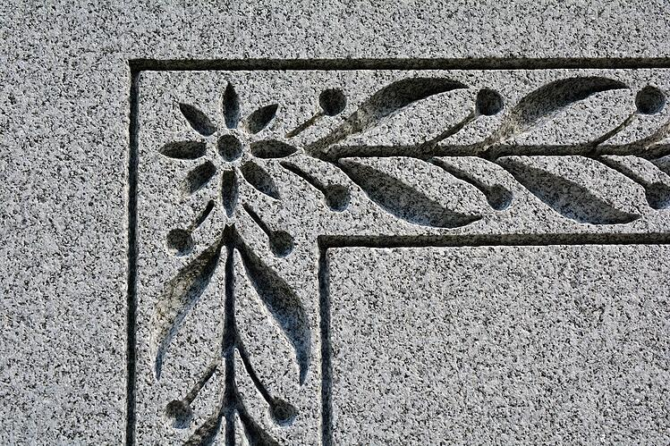 Rock of Ages Blue Gray granite detail carving on headstone