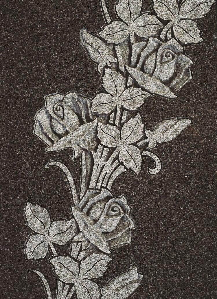 Intricately carved roses in MIDNIGHT BLACK™ granite